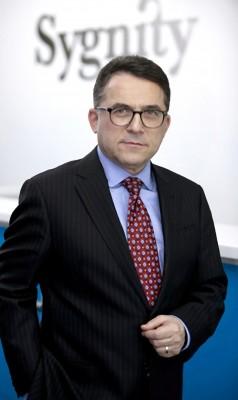 Prezes Zarządu Sygnity SA Janusz R. Guy