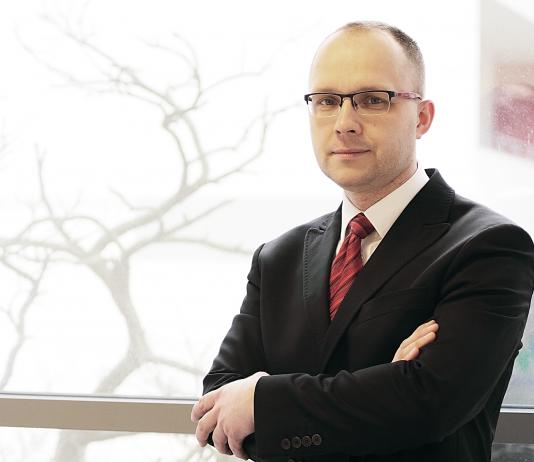 Łukasz Białek, analityk gospodarczy. Fot. serwis agencyjny MondayNews