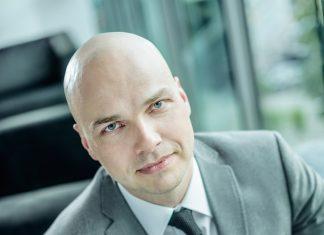 Tomasz Puch, Dyrektor Działu Rynków Kapitałowych Nieruchomości Biurowych i Magazynowych JLL w Polsce