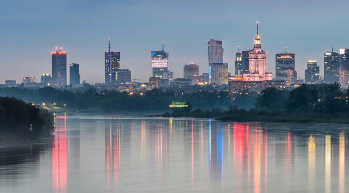 Night panorama of Warsaw skyline, Poland, over Vistula river in the night