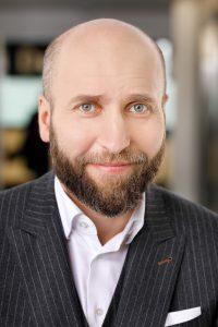 Tomasz Konik, Deloitte