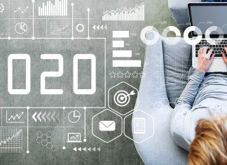 2020 New Year concept with man using a laptop