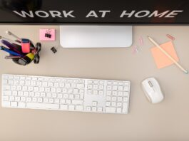 Work at home concept. Top View of Workspace with a computer and office supplies. Flat lay office desk. Copy space